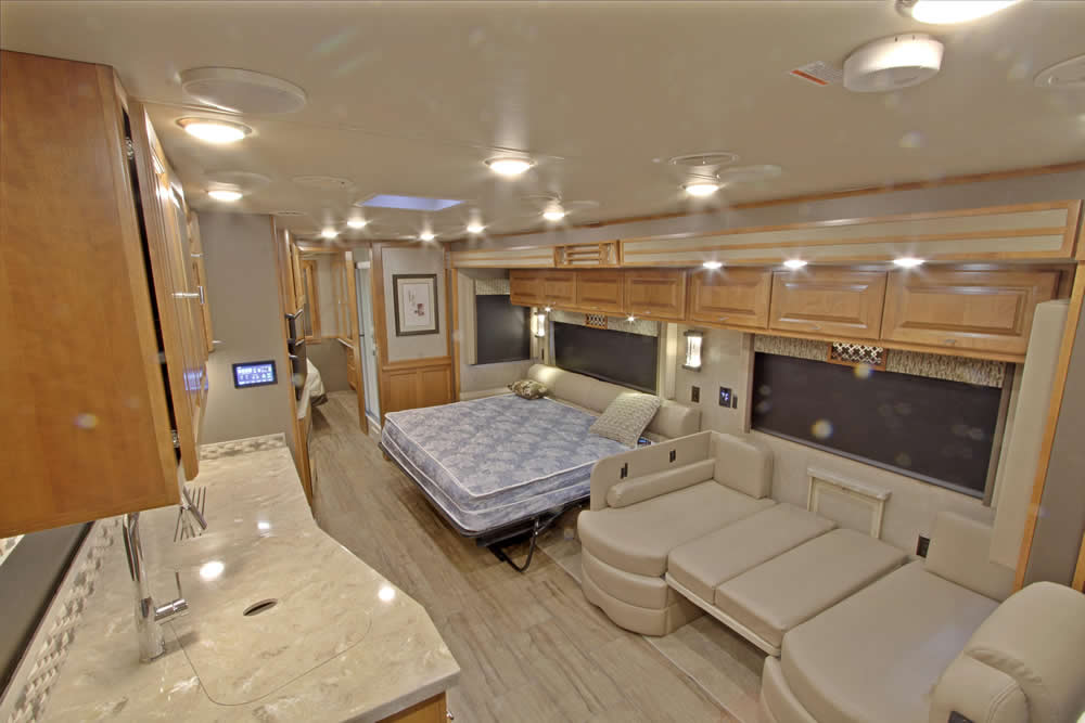 above view of living room, kitchen and queen size bed